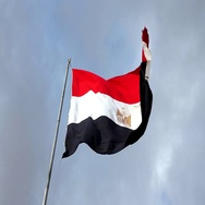 Egypt flag with fabric structure against a cloudy sky Stock Footage