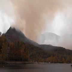 Lake Lure NC mountain wildfire smoke engulfs mtns Stock Footage