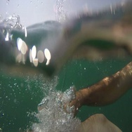 Slow motion of male hand in sea water Stock Footage