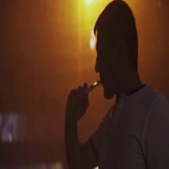 Man exhale steam from electronic cigarette in nightclub. Vaper. Orange spotlight Stock Footage
