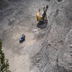 Truck loaded with stones, goes on a granite quarry Stock Footage