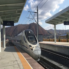 CRH train driving into a railway station Stock Footage