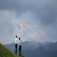 Happy Businessman Running Playing Soaring Bright Colorful Kite Raise in the Sky Stock Footage