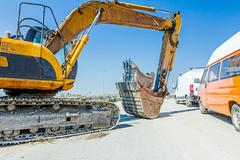 Earthmover at the building site. Stock Photos