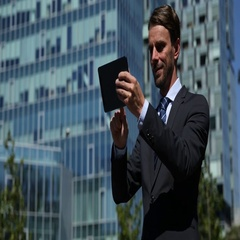Happy Corporate Businessman Use Digital Tablet Check Partner Connection Building Stock Footage