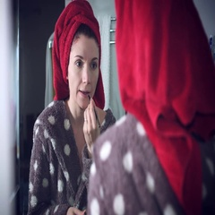 4k Authentic Shot of a Woman Applying Make-up on lips Stock Footage