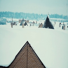 Snowy sloped roofs of residential houses in winter 4K pan shot Stock Footage