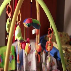 Toys hanging in the crib Stock Footage