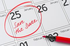 Save the Date written on a calendar - January 25 Stock Photos