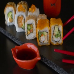 Red chopsticks taking portion of sushi roll, eating sushi roll using chopsticks Stock Footage