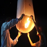 Tourists Releasing Floating Lantern at Yee Peng Festival in Chiang Mai, Thailand Stock Footage