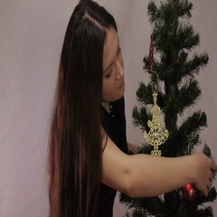 New year, christmas woman decorates a Christmas tree Stock Footage