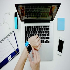 Man looking at his electronic watch at the background of laptop and desk Stock Footage