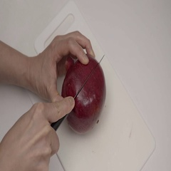 Cutting open a Pomegranate Fruit.  4K UHD. Stock Footage
