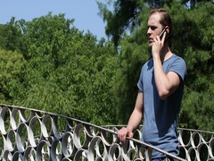 Young American Man Talk Mobile Phone Making Contact Friends Nature Park Location Stock Footage