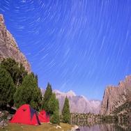 Moon illuminates the mountains. Traces of stars similar to metory. TimeLapse. Stock Footage