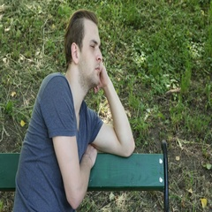 Handsome Young Guy Looking Sad and Pensive Park Bench Negative Thinking Concept Stock Footage