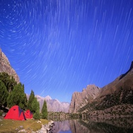 Moonlit night in the mountains. Traces of stars similar to metory. Time Lapse. Stock Footage