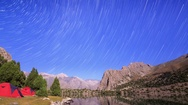 Milky Way in the mountains. Traces of stars similar to metory. Time Lapse. Stock Footage