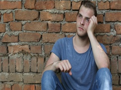 Dreamer Young Boy Loneliness Think Having a Sadness Trouble Back Red Bricks Wall Stock Footage