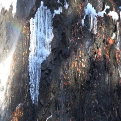 4k Close up winter first frost Radau waterfall rocks with rainbow Harz mountains Stock Footage