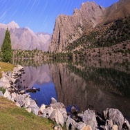 Moonlight over a lake. Traces of stars similar to metory. Time Lapse. Pamir, Stock Footage