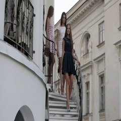 Girls in evening dresses walking down the stairs Stock Footage