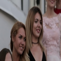 Beautiful girls in evening dresses posing on the ladder outside Stock Footage