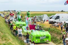 Quievy,France - July 07, 2015:  Teisseire Caravan on a Cobblestone Road Stock Photos