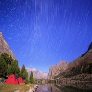 Mountains in the moonlight. Traces of stars similar to metory. Time Lapse. Stock Footage