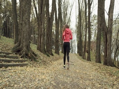 Woman running exercising living healthy lifestyle jogging on forest road. Stock Footage