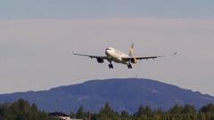 Huge airplane Airbus 330 Thomas Cook Scandinavia landing on runway ambient audio Stock Footage