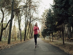 Young runner woman running in park excercising outdoors.  4k red epic. Stock Footage