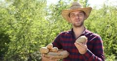 Happy Farmer Man Talk Looking Camera Gardener Hold Brown Potato Organic Farming Stock Footage
