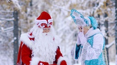 Snow Maiden takes out gift from Father Frost is red bag Stock Footage