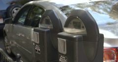 Putting Money into a Parking Meter Stock Footage