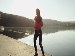 Running - woman runner jogging on road near the lake. Slow motion Stock Footage
