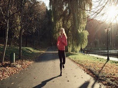 Women runner jogging outside during workout training Stock Footage