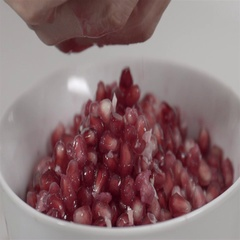 Pomegranate seeds being released in Slow Motion. Stock Footage