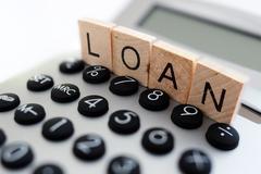 Calculating loan repayments Stock Photos
