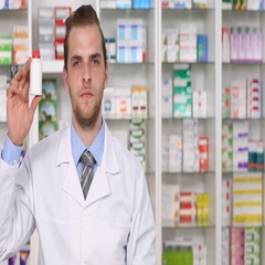 Serious Pharmacist Male Showing a Drug Medicine and Thumb Up Sign Looking Camera Stock Footage