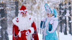 Snow Maiden takes out a gift from red bag interestingly Stock Footage