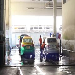 Men washing car at the car wash Stock Footage