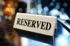 Reserved sign on restaurant table Stock Photos