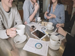 Happy young business team with tablet, documents and coffee clapping hand Stock Footage