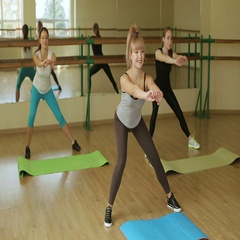 Fitness girls doing Side Lunges exercises doing leg strength training. Stock Footage