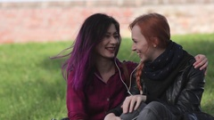 Two best frends girls listening the music Stock Footage