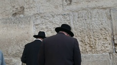 Two jewish men praying at the wailing wall in jerusalem Stock Footage