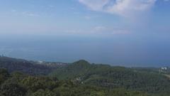 Panorama of Sochi on Black Sea, Caucasus Mountains Stock Footage