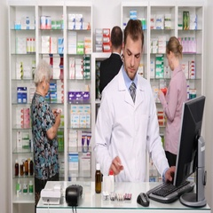 Pharmacist Man Working on a Computer Busy Pharmacy Activity with Customers Shop Stock Footage